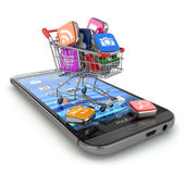 Store of mobile software. Smartphone apps icons in shopping cart — Stock Photo