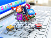 Store of laptop software. Apps icons in shopping cart. — Foto de Stock