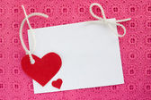 A blank white note card on pink background — Stock Photo