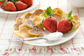 Heart shaped pancakes with fresh strawberries — Stock Photo