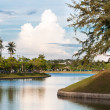 Peaceful lake in tropical town — Stock Photo