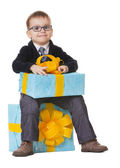 Small happy boy in spectecles with big present — Stock Photo