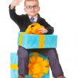 Small boy in spectecles with big present — Stock Photo #12176359