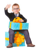 Small boy in spectecles with big present — Stock Photo