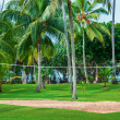 Tropical vacation resort with volleyball court — Stock Photo