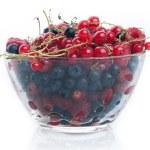 Fresh juicy various berries in glass bowl — Stock Photo #12433351