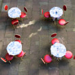 Outdoor cafe tables and chairs — Stock Photo