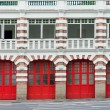 Old fire station with red gates - Stock Photo