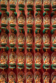 Many Buddhist statues on lotus flowers — Stock Photo