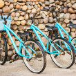 Stock Photo: Three old, rusty blue bicycles