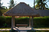 Tropical summerhouse with bench — Stock Photo