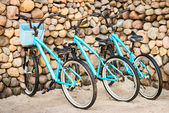 Three old, rusty blue bicycles — Stock Photo