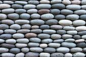 Peddle stone wall — Stock Photo