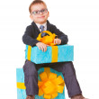 Small boy in spectecles with two big presents — Foto de stock #14890289