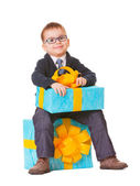 Small boy in spectecles with two big presents — Stock Photo