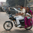 Indian family with two kids on motorcycle — Stock Photo