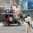 Overloaded indian tuk tuk on typical messy street, India — Stock Photo