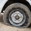Royalty-Free Stock Photo: Deflated damaged tyre