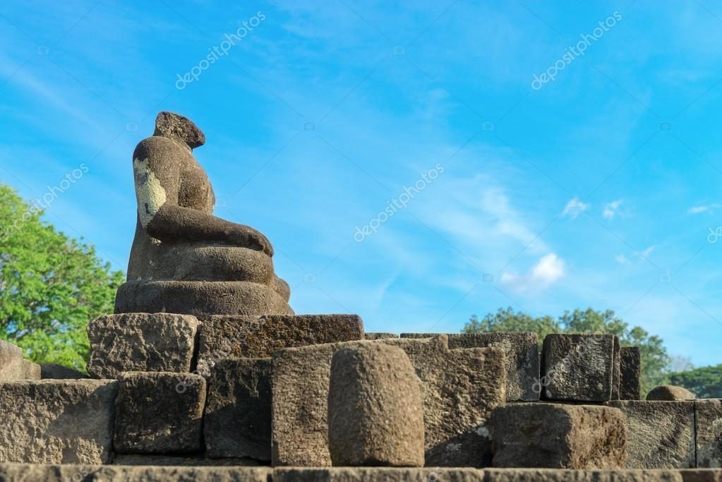 Buddha statue without headin Candi Sewu complex (means 1000 temples). It has 253 building structures (8th Century) and it is the second largest Buddhist temple in Java, Indonesia. — Stock Photo #17818035