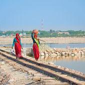 Indian women in sari on railway — Stock Photo
