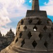 Постер, плакат: Stupa with hidden Buddha statue BorobudurTemple Indonesia