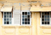 Ramshackle windows with breaked glass — Stock Photo
