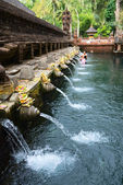 Balinese holy springs in Tirta Empul temple — Stock Photo