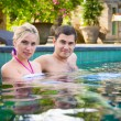 Royalty-Free Stock Photo: Happy young couple relaxing in a swimming pool