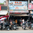 Chaotic motorbike repair service work, India — Stock Photo