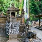 Постер, плакат: Traditional Balinese house of spirits near waterfall