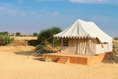 Tent camping site hotel in a desert — Stock Photo