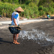 Traditional sesalt production on on volcanic black sand, B — Stock Photo #22483485