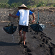 Traditional sesalt production on on volcanic black sand, B — Stock Photo #22484411