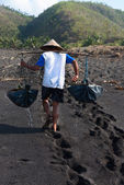 Traditional sea salt production on on the volcanic black sand, B — Stock Photo