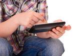 Kid hands using mobile smart phone — Stock Photo