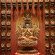 Buddhist statues in a temple — Stock Photo #23562619