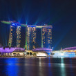 Singapore Marina Bay Sands illuminated by night laser show — Stock Photo