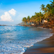 Tropical paradise beach on sunsise light - Stock Photo
