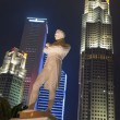 Sir Stamford Raffles statue at night, Singapore - Stock Photo