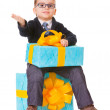 Stock Photo: Small boy in spectecles with big present