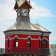 Red clock tower in Cape Town, South Africa - Stok fotoğraf