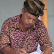 Balinese man maintain records in register book — Foto de Stock