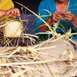 Balinese women make baskets for offerings — Stock Photo