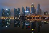 Modern city skyline at night — Stock Photo