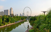 Modern green city with tropical park and lake on front — Stock Photo