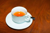 Cup of fresh tea on wooden table — Stock Photo
