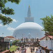 Stock Photo: Pilgrims near white sacred stupa, Anuradhapura, Sri Lanka
