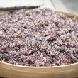 Steam black rice in big wooden plate — Stock Photo