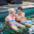 Happy smiling couple in swimming pool — Photo