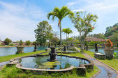 Green tropical park with fountains and ponds — Stock Photo